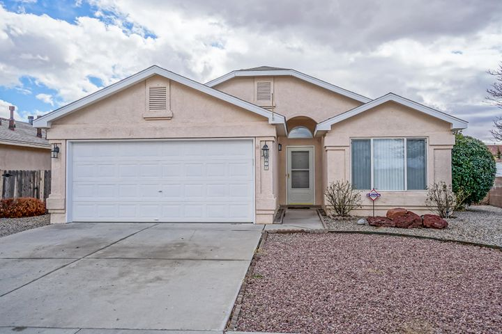 Welcome to this single story home that is ready for you to move into! This is a great open floor plan. The kitchen has a breakfast bar, track lighting & pantry and is open to the living room. The living room has a fire place with tile surrounds & built in shelving. The home has been freshly painted, has plant ledges, vaulted ceilings, arched doorways & nichos. Refrigerator, washer & dryer are included. The backyard has a covered patio & open area. Low maintenance yards.