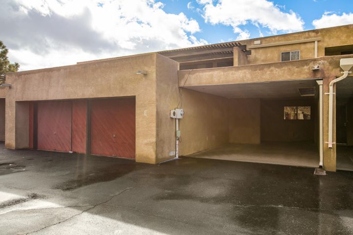 Views of the Sandias and city lights! Nestled in the peaceful neighborhood of Sandia Heights, and conveniently located for easy access to Paseo and Tramway!  This 4 Bedroom, 3 bathroom with tall ceilings, fireplace and Formal Dinning has just been freshly painted and New Carpet.  Ample storage in this lovely townhome. Enjoy the sunrise with a cup of coffee every morning in your balcony off the master bedroom.  One bedroom down stairs. One car garage, and a one car carport. A Great Place to call Home