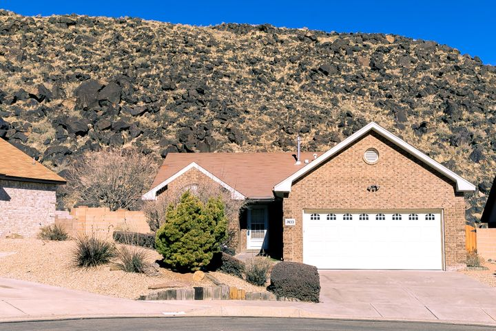Well maintained Opel Jenkins brick home with views of the Petroglyphs and Sandia Mountains. Bright, open floorplan with vaulted ceilings. Large great room has gas log fireplace and ceiling fan. Eat-in kitchen includes gas stove/oven, refrigerator, built-in microwave, dishwasher, pantry. Master bedroom has double sinks and garden tub. Two additional bedrooms and full bath. Newer refrigerated air conditioning, furnace and hot water heater. Two car finished garage with storage. Home backs to open space.  Volcano Vista school district. Close to walking trails, park with dog park, library, shopping, restaurants and freeway.