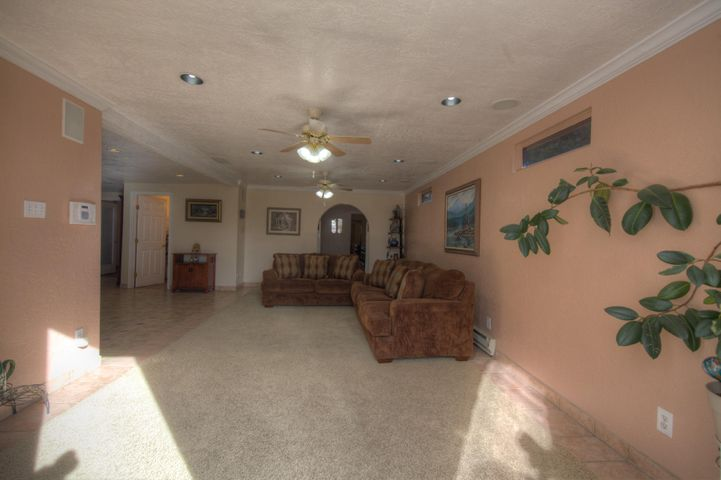 Beautiful North Valley Home, Large Welcoming Living Spaces and Bedrooms, Open Kitchen with Beautiful Open Dining Room, Custom UpgradesThroughout. 3 bedroom's potentially 4. This Home has backyard access and covered outdoor living or workshop spaces. Granite Countertops, Metal Pitched Roof.Conveniently located, close to shopping, restaurants and schools...Come See This Home Today!