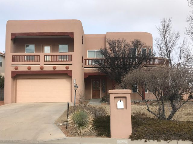 MUST SEE!! This beautiful home located in the fabulous Stonehinge neighborhood seems to have it all!  The full bathroom downstairs gives the potential of the bonus room being used as a second master or an in-law quarters.  It can also be used as an office or a second living area as well.  The kitchen contains all appliances and boasts upgraded counter tops, cabinets, and tile back splash.  The large living room has a custom kiva fireplace. Upstairs you will find the master suite and en suite complete with separate jetted tub and shower.  The master also has access to a covered balcony with magnificent views.  Upstairs you will also find 3 additional bedrooms and another bathroom.  The garage is an over-sized 2 car garage. Outside, both the front and back yards are fully landscaped.