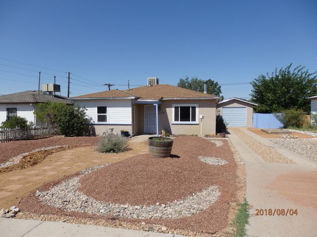 Many, many updates, including Roof, Windows, Gutters, Sisterns, Flooring, HWH. Detached finished Garage(12x22), Large Covered Patio looks out to Big backyard with tree. Close to UNM, Freeway, Uptown and Downtown. All appliances stay. Stable neighborhood.