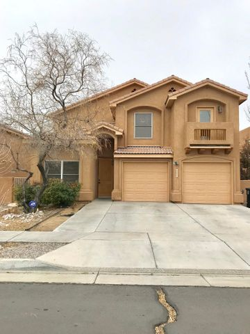 This gorgeous NW home has 5 BEDROOMS, 3 full bathrooms and 1/2 bath. a  master bedroom on the main floor.  A master bedroom  along with 3 other spacious bedrooms on the upper floor. A large living area with a Kiva fireplace and many other great amenities! Come check out this lovely home today!