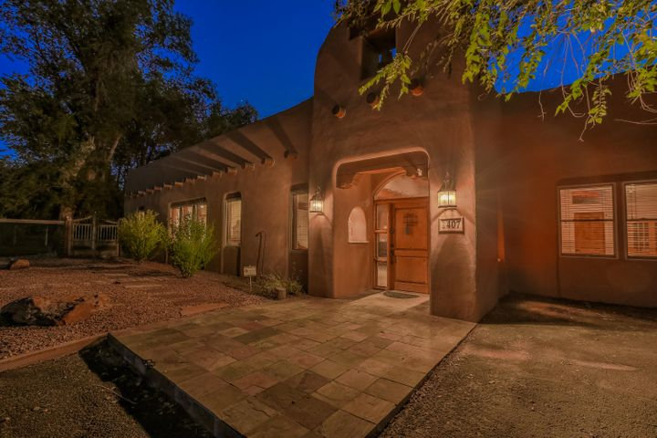 This mission style home was completely renovated for most discriminating taste keeping the structure consistent with hand placed Adobes. You will immediately feel  warmth of the surreal adobe walls when you step inside. located in the peaceful, warm, farming village of Corrales. Open bright floor plan, with Vigas and Latilla ceilings. Stunning custom kitchen with all the equipment required for the discriminating chef, granite, all Wolf appliances, Sub-zero refrigerator, wine cooler, radiant heat & 2 HVAC units. Enjoy the courtyard in the center of home which provides access to the home from all four sides. Moving outdoors- Enjoy the beautiful park like yard, trees, and skyline. Horses welcome on this 1.5 ac. Fantastic community with bike & walking trails. Come make this your new Home.