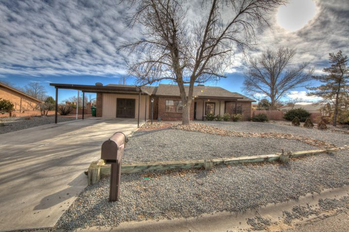 **Open Saturday, 2/23 12-3 and Sunday, 2/24 2-4!!** Hard to find one story home with 4 bedrooms and a study/office, that also has multiple living areas. New easy care Southwest gravel landscape greets you and adds tremendous curb appeal. The kitchen has been fully updated with granite counter tops, tile back splash, and stainless steel appliances. There is solid surface updated flooring throughout. This home also has a cozy wood fireplace and huge dining area. Large corner lot with with walled backyard and storage shed, and plenty of room for an RV or boat. Versatile and functional floor plan ready for for it's new owner, make this your home today.