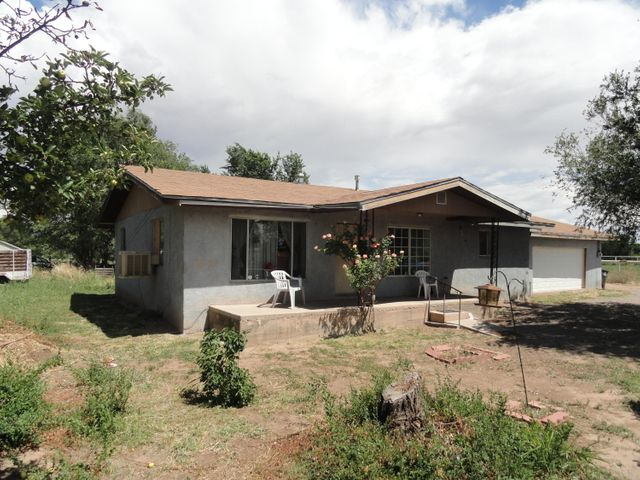 Location! One owner adobe home on 1.73 Acres. 3 good size bedrooms and 2 baths. Close to everything. Huge back yard would be perfect for entertaining, horses, or any outdoor hobbies.