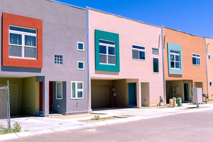 Brand new Stunning Custom Contemporary Town Home in the NE Heights. With Mountain Views. Beautiful light and ambiance  views, boasting beautiful entrance with custom wood staircase, Kitchen upstairs, refrigerated air, tankless water heater, Anderson Windows, 2x6 construction, with Quartz countertops,ss appliances,Dumbwaiter. Solid wood doors A 95% efficient forced air heater.Tile throughout entire home.Large master suite upstairs.The sharp and clean lines only accentuates the open and bright architecture.This home is absolutely Beautiful...Don't MISS IT!!