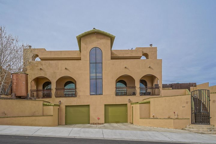 Tuscan style 3 level custom home with elevator (installed in 2018) 5 bedrooms, 2 3/4 bathrooms, 2 car garage plus work area and bonus room for storage or mancave.  Amazing views from 1,000 sf master suite on top level.  Master suite features exterior patios from bedroom and bathroom.  Romeo & Juliet balcony is great place to sit and enjoy the view.  Master bedroom also features coffee bar.  Custom knotty alder cabinets throughout.  Two wood  burning custom fireplaces, bonus office area, 60'' stove installed in 2018.  Oversize shower and jetted tub in master bath.  Two walk-in closets.  Brick flooring and dramatic foyer entry make this home a must see!  Close to hospitals, schools, shopping, restaurants and public transportation.  Great home for multi-generational living. Open floorplan!