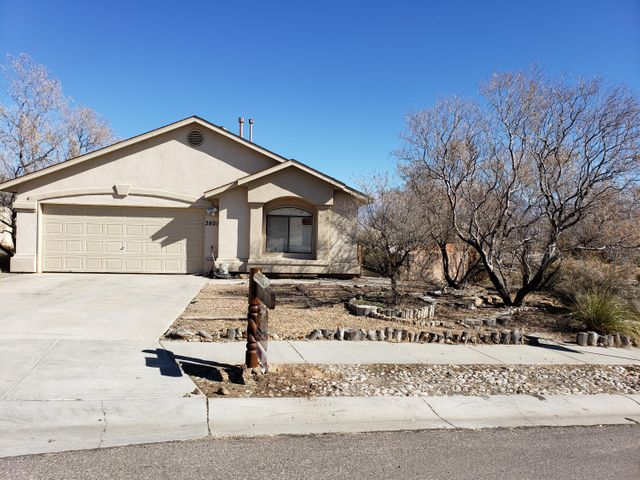 Expansive views of the majestic Sandia mountains and city lights. Huge corner lot that is 0.4 of an acre-perfect for entertaining or for all of your toys (potential to add backyard access). Light-filled great room welcomes you with vaulted ceilings, new laminate wood floors,  and cozy fireplace. Additional den/office with new carpet. Open kitchen has tile floors and stainless steel appliances. Bathrooms have tile floor and home has AC! Sliding glass door out to east facing back patio with magnificent view. Walled backyard has endless potential--room for a garden, toys, and there is also room for a POOL. This home has many great features and no HOA.