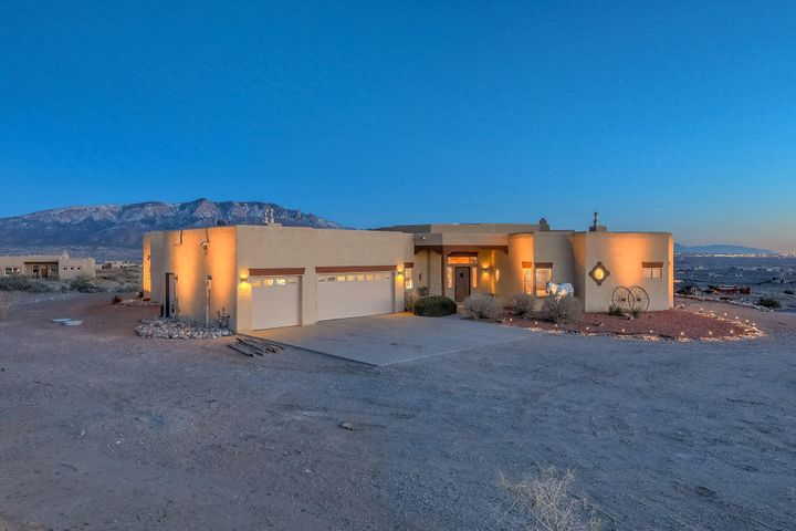 Owned by an Actress and Model, this Stunning Custom-built home on 3 acres of Horse Property in Rio Rancho is looking for you!  INCLUDES a 1-3/4 acre neighboring lot!  Unobstructed Mountain and Valley views from North to South!  Open Gourmet Kitchen with Granite countertops, Island, Gas cook-top, Double ovens.  Kitchen opens to the Living Room and Dining area, all with large picture windows to take in the view and spacious with high ceilings.  Plenty of Architectural features in this home. Cozy Living room with Kiva fireplace, Built-in sound system conveys, Beam ceiling, built-in Nichos with lighting. Separate formal Dining space OR a second Living space.  Two Master bedrooms- Primary Master bedroom has huge walk-in closet, bath with dual-sided gas fireplace, Jetted tub and walk-in shower