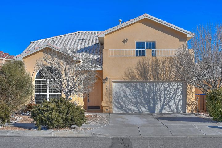 Welcome home to Paradise Bluffs! Spacious 5 bedroom Fuller Home with lots of updates! Spacious floor plan with multiple living areas. Soaring living room with chic concrete floors. True chef's kitchen with upgraded stainless steel appliances, granite and designer backsplash. Family room with cozy fireplace is perfect for gatherings. Out back you will find a verdant retreat - private yard with patio, outdoor kitchen and numerous fruit trees. Upstairs you will find 4 bedrooms, all with new carpet. Private master suite with private deck and huge closet. The master bath boasts soaking tub, separate shower and stunning vanities. All bathrooms have been updated as well. Convenient NW location just moments to schools, golf, main roads and shopping. Home is here!