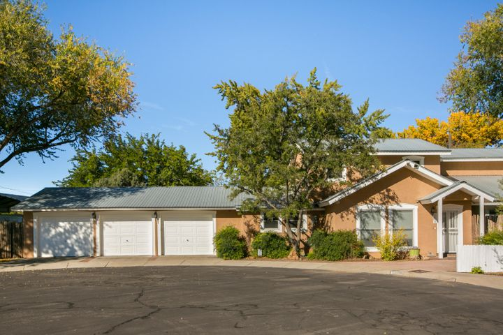 A Truly RARE FIND. This North Valley Country Style Home is nestled in the heart of Albuquerque and sits on a .3 acre lot in a cul de sac w/ ditch irrigation & mature trees. It was built with Energy Efficiency in mind with R-55 & R-40 Insulation, Injected Expandable Foam Insulation in the 6'' walls & has a 4 bedroom, 3 bath, 2827sf floor plan including a Wraparound Balcony off the Master Bedroom Suite. This warm and charming home has a wonderful floor plan - open but with defined spaces. The recently REMODELED Huge State of the Art Kitchen Features all new Cabinets, Marble and Boos Butcher Block Counter Tops, a large Stainless Steel Counter topped Island, all New Appliances including a Blue Star 30'' Chefs Gas Oven and an Electric Oven. Perfect for an Executive Chef and a Couple of Sous Che
