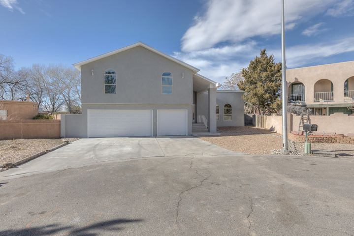 Don't miss out on a unique opportunity to live in an updated home in the heart of the North Valley! This spacious home has 4 bedrooms, 3 bathrooms, an open concept layout, a wet bar, and a great patio that is sure to impress!Upgrades include: STAINLESS STEEL appliances, REFRIGERATED AIR, GRANITE counter tops, CUSTOM cabinets, Pro Panel roof, furnaces, windows, stucco, fresh paint, garage doors, and new carpet and tile throughout. The backyard is ready for your ideas and perfect for entertaining. Home is situated in a Cul-de-sac and in close proximity to shops, restaurants, and bosque trails.
