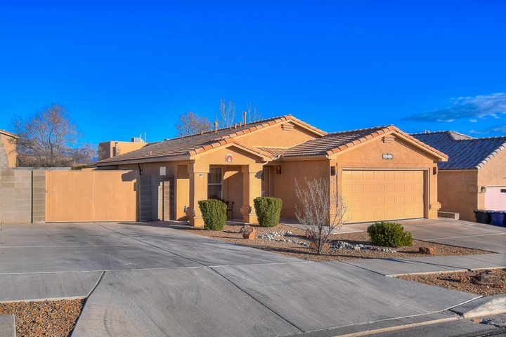 ***Open Sunday 2/10 from 1-4pm, if still available*** Exquisite in every way. Magnificent, well-manicured curb presence makes an absolutely stunning but accurate first impression of what's to come. Yes, those are custom bkyd access gates - notice how the curb has been revised and there's even a large concrete parking pad behind them. Cross the threshold and... wow. Special features include beautiful Spanish tile roof, interior wood-looking tile, 3 bedrooms plus an open study behind French doors, beautiful stainless steel appliance suit and thick granite slab kitchen counters, relaxing gas log fireplace, spacious vaulted ceilings, relaxing garden tub & dual sinks in master, and the BEST private outdoor living ever under an oversized covered patio.