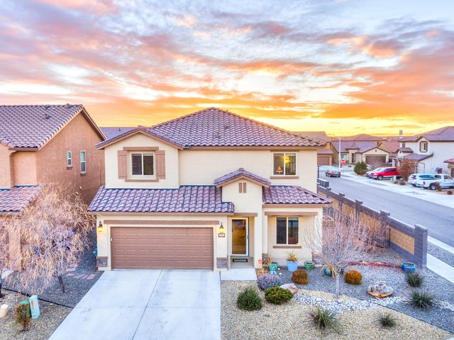 Beautiful like-new home on a corner lot in the desirable community of The Boulders.  This home features a large kitchen and pantry, with granite counters and stainless KitchenAid appliances.   In addition to the 4 bedrooms, it also has a study, and a huge loft!  The downstairs bedroom includes a full bath perfect for a guest room, or mother-in-law suite. The yard is a gardener's paradise with a peach and apple tree, rose bushes, a garden, and many beautiful plants that will bloom through the warmer months.   There is also turf and a drip system for low-maintenance, as well as a water fountain, and fire pit!  The garage has an epoxy floor and great racks for storage. The Boulders community has 2 parks, with walking trails, close to great schools, and an easy commute anywhere in the city!