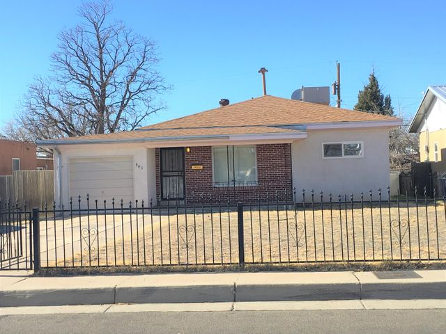 Take a second look! New & Improved List Price! Adorable and affordable, little casita, close to the KAFB, Sandia Labs and Airport. Very nice floor-plan w/split bedrooms & two living areas. Updates include, roof December 14, 2018, Master-Cool  and water heater in 2015.  Thermal windows by Glass Rite.  Trim and fascia just painted, orange burg sewer lined just replaced by TLC Plumbing. Original hardwood floors in living room and the two front bedrooms. Tile floors in both baths. Covered front porch with mountain views and wrought iron fenced -in front yard. Large walled backyard with raised garden beds ideal for planting vegetables, cloths-line and storage shed.  Washer, dryer and refrigerator conveys in as-is condition. Freshly painted & move-in-ready. Show and Sell!!!
