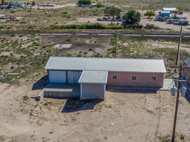 Formally known as the Jersey Gold Dairy, this 18.57 acre piece of property is filled with opportunity at an unbelievable price. The 1192 sqf house is made out of adobe. The property has huge commodity barns, giant covered sheds, workshop, corrals and much more. Must come see this amazing property! Property is sold as is. Current appraisal has been done, and it is well above what asking price is. You can't miss this deal!
