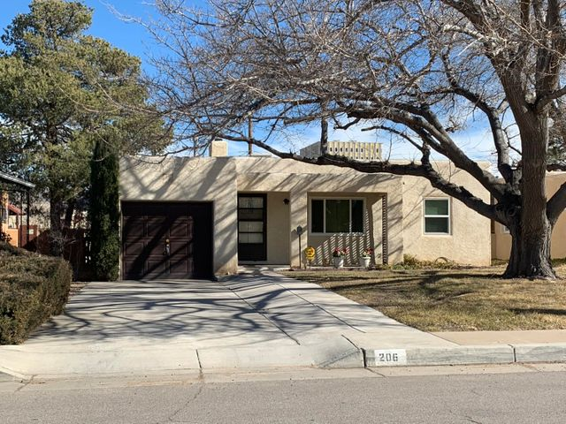 Great opportunity in the UNM district.  Newly refinished hard wood floors.  Original plaster walls with cove ceilings. The home has all new windows and paint.  Come see this charming UNM home with 2BDR's/1BA/1CG and a HUGE BACKYARD!!! .  6 ft wall for privacy & plenty of room to garden and entertain family & friends. Established neighborhood in excellent location.  Just 2 miles to UNM, close to shopping, & Nob Hill.  This home is sparkling clean and move in ready.  Call me today to schedule your private showing.