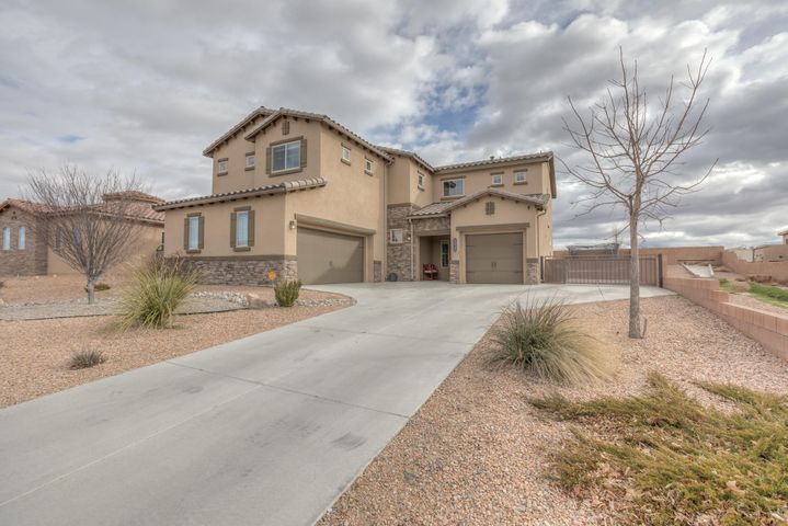 This is the perfect place to call home in beautiful Cabezon!  This is a stunning 5 bedroom home with a bedroom and 3/4 bath downstairs.  The expansive master suite has a sitting room with a balcony that overlooks the beautiful Sandias!  The master bath also has separate his and hers walk-in closets. 3 additional bedrooms, loft area, guest bath and laundry room complete the upstairs.  You will love cooking in the gorgeous kitchen with a HUGE walk-in pantry.  Entertain in and enjoy the fully landscaped backyard complete with a wood burning fireplace and built in grill.