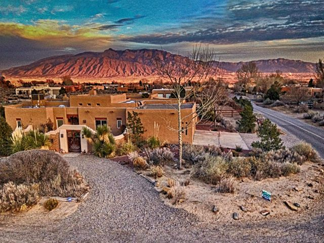 Enjoy this open spacious floor plan (not chambered like many Corrales homes) with Granite counters in Kitchen and MB and SS appliances.  Great Horse Property.   Beautiful full Sandia Views from nearly every window and covered back Patio.   Seller owns 5.44 KW 17 Panel Solar System hidden from View and not on Home Roof.   Barn is adobe style with 2 full horse stalls and three storage/tack rooms.  No carpeting in this Home.    Finely  Landscaped with Decorative Metal Gates for both front and rear Courtyards.Nice size bedrooms and walk in closets with a Office/Study adjacent to Living area.   Clean and Rich Induction Stove w compatible potware.  Smart Phone apps can monitor Solar Panels, Home Energy usage, Garage Door, and Sprinkler systems. This home is well cared for. Seller is Realtor.