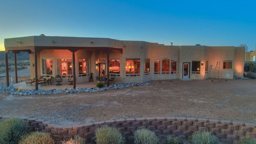 Owned by an Actress and Model, this Stunning Custom-built home is on 3 acres of Horse Property.  Unobstructed panoramic Mountain and Valley views!Open Gourmet Kitchen has Granite countertops, eat-in counter, Island, Gas cook-top, Double ovens and is open to the Living Room and Dining area, all with large picture windows to take in those panoramic views.  Spacious entry/foyer has hand-crafted door and custom tile floor medallion.  Numerous Architectural features such as the many built-in Nichos with lighting.  Two bedrooms with full baths and two bedrooms which share a full bath Jack and Jill Style. Plenty of room for your RV and toys or horses!The additional 1.74 acre neighboring vacant lot which was originally a package deal is now listed separately.  See MLS #943565.