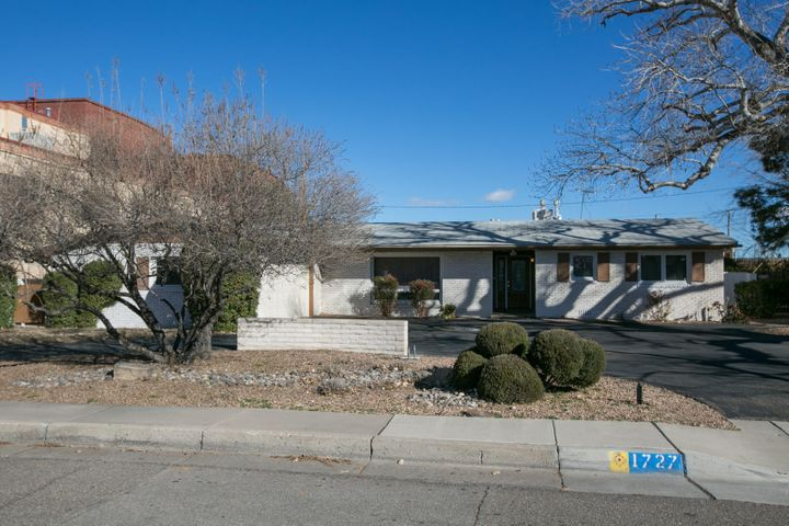 Wonderful opportunity to be in the heart of the Albuquerque Country Club neighborhood and walking distance to great restaurants and entertainment. This wonderful single story home has been remodeled from top to bottom and features beautiful hardwood floors throughout, an open concept floorplan, a huge master suite with a sitting area, a huge master bath and walk in closet, and a private and tranquil backyard with an in ground gunite pool! The sellers spared no expense when renovating, the kitchen features beautiful custom cabinetry, stainless steel appliances, and rich granite. The kitchen is wide open to the great room which features a cozy fireplace. Enjoy the charm of an established neighborhood with the modern convenience of a fully renovated home! Walking distance to the county club!