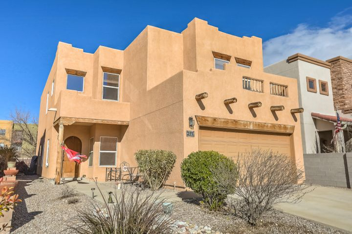 Welcome to this well designed property on a quiet cul-de-sac along the bluff above Corrales.   Living room has gas log fireplace, raised ceilings and lots of windows. Opens to dining and kitchen areas.  A large office and full bath on lower level which could be a bedroom suite. Upstairs has the master suite, great loft, and 2 bedrooms that share a full bath.  Home has tinted windows.  Refrigerated air has 2 units.   Great mountain and city lights views.