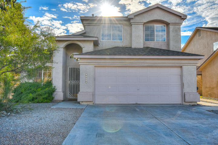 Ventana Ranch home offers Brand New Paint, Brand New Carpet and Brand new wood laminate floors!  This lovely home has 2 living areas, large master bedroom and master closet with views of the Sandias from the master bedroom.  The master bath has a separate tub and shower.   Located right in the Ventana Ranch School district, with a great sized backyard, walking trails, nearby parks/open space this Ventana Ranch home will not last long!