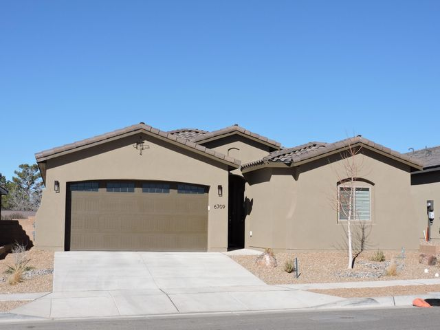 NE area, great location near many restaurants (approx. 14!) and numerous shops all within 4 miles; Smiths, Trader Joes, Kohls, Target, Lowes, etc.  Gently lived in- New Abrazos Jane Model in excellent condition with extra options, approx. $35,000 in upgrades! Quartz counter tops, ceramic tile in all areas except 3 BR's. Open floor plan-great room with corner fireplace. Large kitchen island and open space dining area. Two large pantries, 8ft interior doors with soaring ceilings. SS appliances, refrigerator, washer/dryer remain. All window coverings stay. Kinetico whole house water softener and filter stays. Wireless thermostat-Nest controller, control from your car or office. 2+ tandem garage with numerous shelves for raised storage, tankless waterheater. Mountain Views! Landscaping, drip s