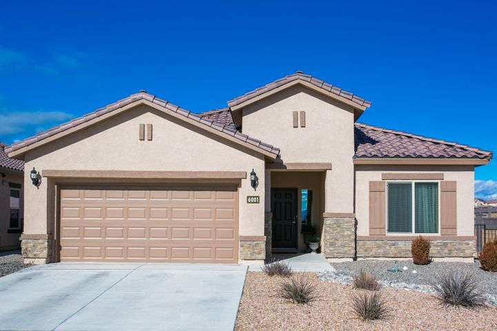Fabulously decorated 4 bedroom single story Pulte Home in desirable Master Planned Boulders Community. 9 ft over sized ceilings. A wide open floor plan with gourmet kitchen and huge granite island with bar seating, dark wood cabinets, custom subway tile back splash, SS appliances, 5 burner gas range. Luxurious master bath suite with separate tub and glass shower with sparkling nickel hardware, beautiful open bay window offering lots of natural light. HERS Rating of 65 or better for energy efficiency tank less gas water heater, refrigerated air. The gracious great room centers around the welcoming fireplace. Professionally landscaped back yard and covered patio, perfect for your entertaining. Corner lot for extra privacy and views! Near by park, & excellent schools. Come see this gem!!