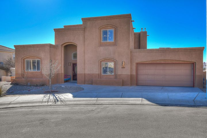 Looking for views?  Look no further! Beautiful, custom home located on a quite culdesac is waiting for you. It offers a large and very private master suite upstairs with two walk in closets, double sinks, separate shower and jetted tub. Open and bright gourmet kitchen with island, nook, large arch looking into family room, skylights and two bedrooms downstairs. Nice lot with 0.38 acres and spectacular panoramic views to enjoy those New Mexico summer nights. The 2 car garage is oversized! New carpet and paint, kitchen appliances.