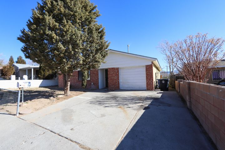 Easy access to shopping, highway, schools. Home needs work but has great potential. Spacious rooms, 2 large living areas, kitchen with eat in area, great yard space! This is a diamond in the rough at an excellent price! Come take a look!