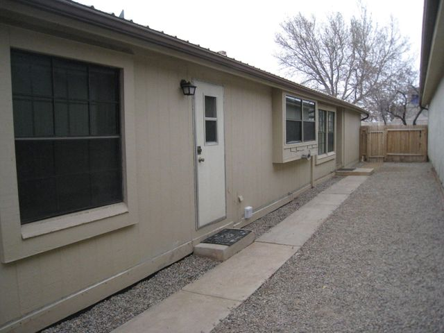 Land is Owned and not Leased!  This Cameo Manufactured home has undergone some recent interior changes such as new carpets & laminate flooring, paint, granite counters, new sinks in kitchen.  Exterior changes include bringing the foundation to current FHA Loan guidelines and  landscaping.  Enter the home into the Living Room which features a Wood Burning Fireplace.  The Open Floor plan has a Large Kitchen with a Kitchen Island and a Dining Room.  There are three spacious Bedrooms and two Full Bathrooms.  There is a storage space located in the area of the One Car Carport.