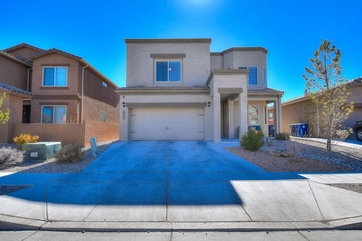Gorgeous Green Built Home in Desired The Trails Community! Shows like a Model Home Ready for New Owners! Green New Mexico Silver Certified Home!  Spacious 4 bedroom Home plus Cozy Loft with an office Downstairs! Open Beautiful kitchen with Granite counter tops & island! Open floor plan! Tile in All Wet areas Including Living Room!  Large Master Bedroom with Gorgeous Master Bath w/Separate Shower and Garden Tub!  Mud Room area from Garage! Covered patio in backyard for outdoor enjoyment! Fully Landscaped! Must See!