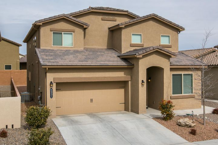 Home features - Downstairs master suite with elegant bathroom, walk in closet with laundry room access, 2 large bedrooms plus additional living space upstairs,  additional bedroom with full bath upstairs as well, granite counter tops with executive kitchen cabinets and island, dramatic ceiling in the family room, covered patio and much more!