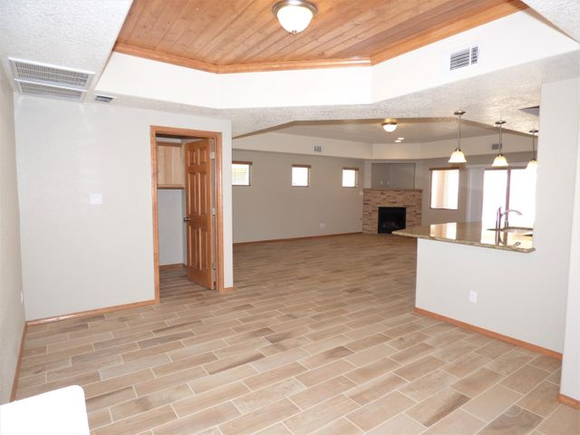 Fantastic New Construction Ready to move into. Beautiful Low Maintenance Front & Back Landscaping (Backyard landscaped up to Lower Retaining Wall). Wide Open Living Spaces, Pretty, Wood Look Tile Floor Thru-Out W/Exception to Carpet in the 3 Bedrms. Enjoy the Great Rm with it's Cozy Gas Log Fireplace that Opens to an Amazing Kitchen W/Large Breakfast Bar/Island, Stainless Steel Appliances, Granite Counter tops & Tons of Hickory Cabinets.The Master Suite Includes Dbl Vanity, Pretty Walk-In, Tiled Shower & there R 2 Closets. Ample Sized Secondary Bedrms W/Full Bath, Tile Floor & Granite Counter Tops. Dining Rm With it's T&G Ceiling Could be Sitting/Reading or Office. Huge Garage W/Extra Depth. Refrigerated Air, Low-E Windows, GREEN Built to Gold Level for Utility Savings & Comfort.