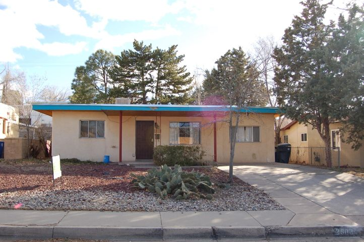 Great opportunity to own near UNM, CNM Main Campus, Airport area.  Cute 2 bedroom, 1 bath home with lots of charm.  Hardwood floors and new paint.  New electrical panel installed.  Nice sized back yard with chicken coop, and fenced off area.  Raised planters and mature trees.
