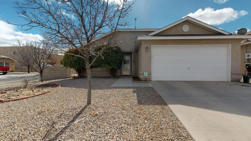 Take a look at this beautiful home located on a larger corner lot in the Ridgeview subdivision! This 3 bedroom and 2 bathroom home features beautiful upgraded laminate wood flooring throughout main living area and bedrooms. Cozy up next to the gas fireplace in the spacious living area with vaulted ceilings. Open eat-in kitchen with stainless steel appliances. Master suite with walk-in closet and private bath. Both additional bedrooms have walk-in closets for all your storage needs! Private backyard with open patio perfect for those family BBQ's and gatherings! This one won't last long!