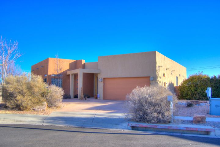 Stunning home located on a over sized lot in popular area of West Side!  Large master and the bathroom has double sinks, jetted tub and is separate from other bedrooms which are downstairs.  Gourmet kitchen that has granite counter tops, chef island and open to dining room and living area. Two way fireplace to enjoy while having dinner or in the living room.  Large 18x13 workshop with newer roof. Main home roof replaced five years ago.  Large balcany with city views.  Popular school district !