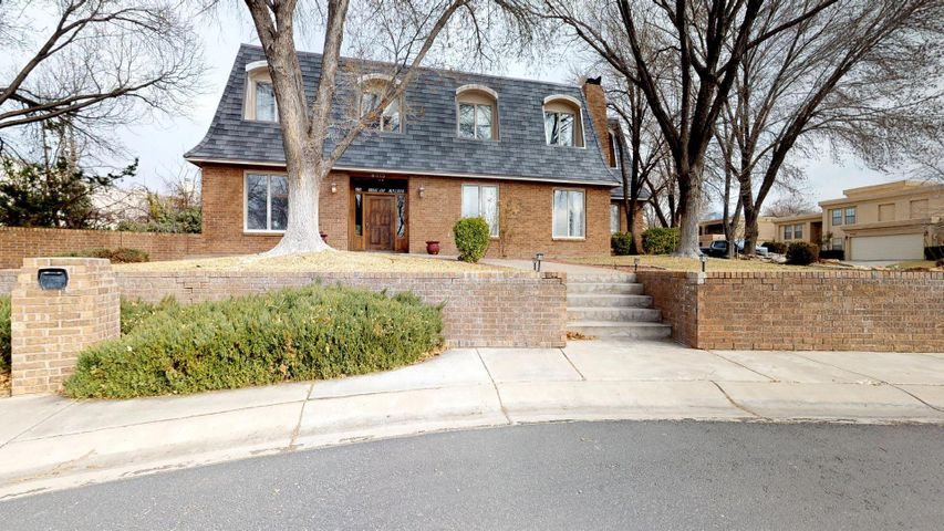 Stunning and spacious Tanoan Estate off quiet cul-de-sac with cascading water feature enhancing homes curb appeal.  Updated and open concept kitchen, eat in bar with French doors leading to backyard oasis . Fabulous home for holiday gatherings with oversized dining room with fireplace.   Multiple living areas including a fully finished walk-out basement with kitchenette. Backyard paradise includes an inground pool with separate hot tub, covered gazebo in well landscaped private yard. Spacious master suite with large walk in closet and separate reading area with fireplace. Two additional bedrooms upstairs with jack and jill bathroom.