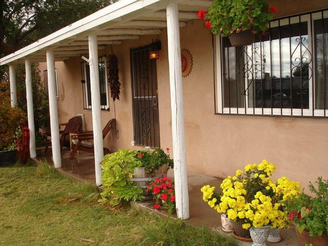 What a find!  Two homes with an additional 2 vacant lots to develop (or just farm!).  The main house features hardwood floors, radiant hot water heat, newer thermal windows, updated kitchen with granite counter tops and stainless appliances and a very large living room with w/b fireplace.  The casita features one bedroom, full bath, and is approx. 600 sq. ft. and rents for 750.00   per month (main house is rented for 1150.00 per month).  In addition to city water and sewer there is an irrigation well and the property has water rights for irrigating from the ditch.  The neighborhood is in rapid redevelopment with new homes being built close by.  The access road in front is actually a dedicated bike path that will, eventually be landscaped etc. Tremendous potential here!