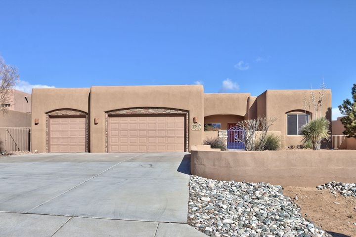 Gorgeous contemporary southwest home spotlighted with a greatroom showered in light from a wall of windows. A chef's kitchen gleaming with granite and stainless appliances including a wine fridge and large walk in pantry joins the living and dining areas. Great entertaining and family gathering spaces complement the three bedrooms and home office(4th bedroom) off the entry. A private Master suite charms you with views, travertine and a two way fireplace. Curves, corbels and warm woods are charmingly New Mexico. A covered portal is pleasant for entertaining and dining alfresco. This half acre lot poised high on a hill offers mountain and city views, separate yards, raised beds, trees, bushes and personality. Located conveniently by Rust Medical Center, restaurants and main boulevards. Wow!