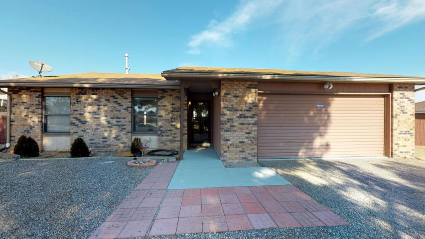 Big views of the Sandia Crest and a great price on this recently updated, single level home in Ceder Hills. Well cared for inside and out, with a low maintenance yard and huge shade trees out front. Nice open floor plan with a dining nook and breakfast bar (floor plan available by request). No carpets to clean because your home has only high quality laminate and tile flooring throughout. Large garage with room to work and enough room on either side of the home to allow easy back yard access for all sorts of vehicles with some fence modification. Hey, you may not care much now, but you'll enjoy the refrigerated air come summer and the great views from your cool, covered patio. Easy access to shopping, schools and services.