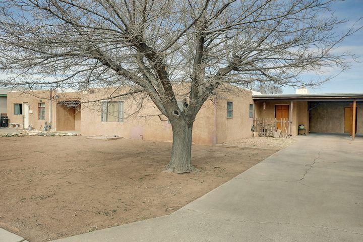 OPEN HOUSE FRIDAY MARCH 22 FROM 3:00-5:00 PM!!! Great opportunity for a beautiful home on a 1/2 acre lot in the North Valley! This home offers spacious living throughout. Two open living areas, a large kitchen, and newly updated bathroom. Comes with a storage shed and mother in law quarters attached. The charming main living area offers an exposed rock wall along with a fireplace. Backyard comes fully fenced off and includes an in ground pool! Just minutes away from the Rio Grande!