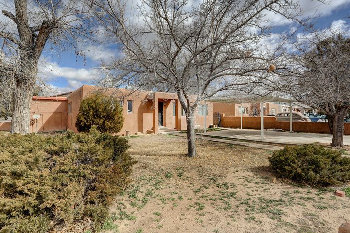 Great opportunity in this North Valley gem... located just off Rio Grande, enjoy the convenience of easy access to the highway & local shopping.  Sitting on a corner lot in a mature tree filled neighborhood, this property features single floor Main House (3br, 2ba, w/ 2 living areas, 1762sqft); detached Casita (1br, 1ba, kitchen & living room, 528sqft); and Work Shop (12'x8').  Original hardwood floors have recently been exposed.  Make this the home of your dreams (include remodel costs in your mortgage w/ FHA 203K loan).  PLUS, use the Casita as either an In-Law Suite or Rental Property (market rent approx $800/mo).  UPDATES include: HE Furnace; Refrigerated A/C & Master Cooler (dual system); insulated duct work; copper potable water lines; gas lines; etc.