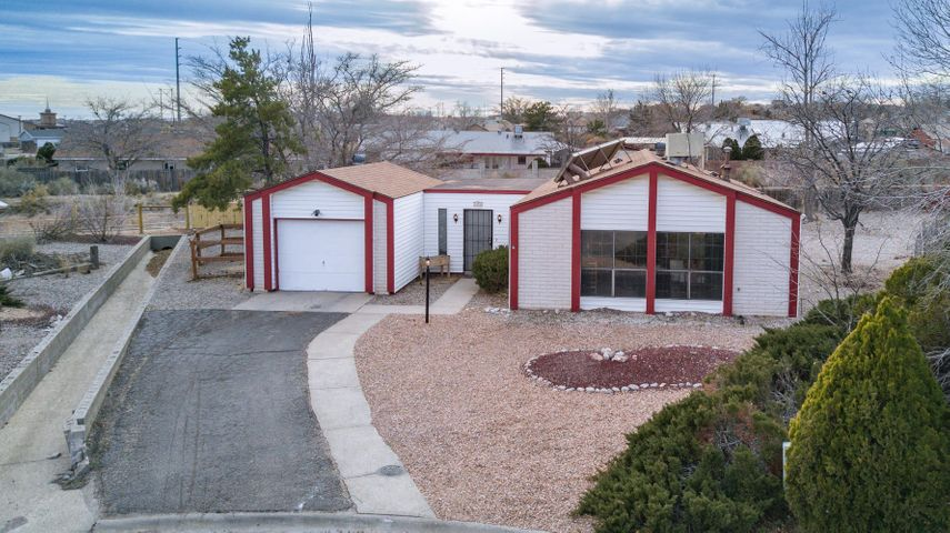 Cul-de-sac living on large roomy lot in Rio Rancho. Cute 2 bedroom, 1 bath, 1 car garage has lots to offer. 2 large living areas, roomy dining area, kitchen with stylish back splash & painted cabinets. Newer lighting fixtures throughout. Mostly tile, with carpet only in the 2 bedrooms.  No board & batten, vinyl siding! Shingle roof & TPO roof installed in 2016. Pre-inspected & most repairs completed. Will be re-inspected soon  BIG backyard waiting for your creativity! No neighbors directly behind. Walking path behind the home is part of the Lisbon Channel Project.  On the southern end of Rio Rancho so you can access both Albuquerque & Rio Rancho shopping, theaters, restaurants, hospital & much more. If that's not enough, ALL appliances including refrigerator, washer & dryer stay!