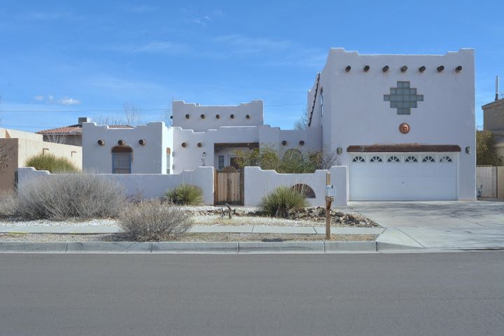 This home offers the signature of New Mexico! Vigas & Latilla ceilings, Southwest Charm, Kiva Fireplace, Exposed Adobe accent wall, Shady backyard with private shaded balcony,tile flooring with wood floors in the Owners suite! Plus, the owners suite offers a Double head shower with steam, over-sized jetted tub, double sinks, 2 huge walk in closets and a linen closet! The owners suite is up and away from the rest of the home. Glass block accents and much more.