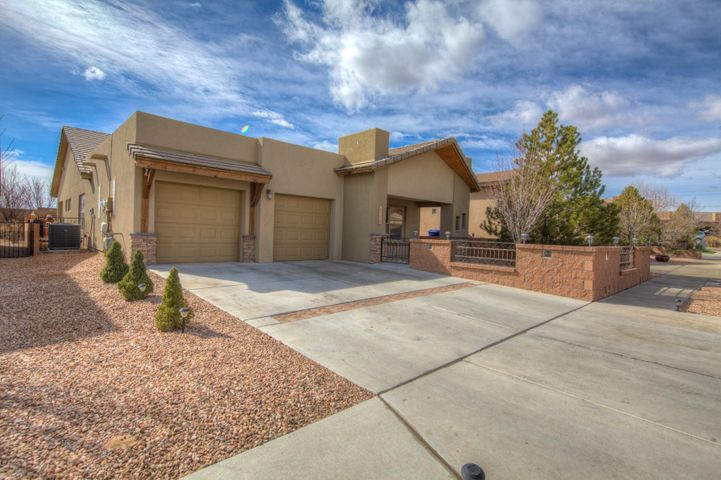 This four bedroom Paul Allen Extreme Green Home is sure to impress! Paul Allen ''Extreme Green'' homes means building environmentally sensitive, eco friendly homes that exceed the Energy Star guidelines, exceed the Build Green NM ''gold'' guidelines and meet or exceed the energy efficiency guidelines established by the State of New Mexico. This Welcoming Floor Plan is ideal for a growing family, separate bedroom and living space for guests, teen or in-laws! Granite Counter Tops, Tankless Water Heater, Large Master with gorgeous spa like en-suite. Fully paid for Solar Panels. Fully low maintenance landscaping, close to CNM west campus.
