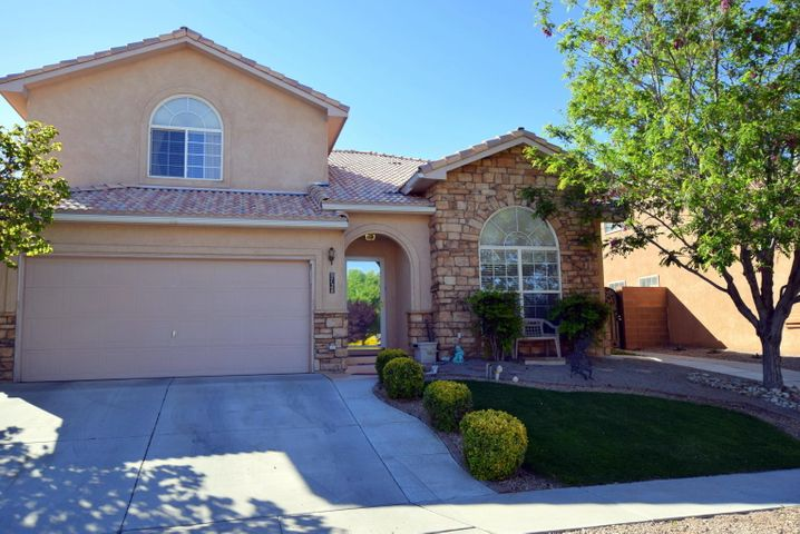 Custom built, 5 bedroom home, great for a family!  Home boasts many extras, bedroom on main level. Walk in closets. Gaze at the Sandia's & city lights from the extended balcony off the master suite. Escape to your oasis in the beautifly, one of a kind  landscaped backyard. Stunning flower gardens. Excellent for entertaining!  Close to shopping and schools.