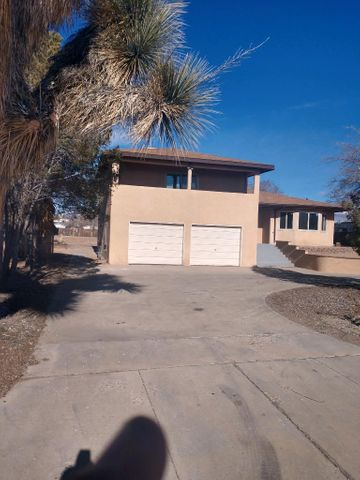 Completely renovated tri-level home on a 1/2 acre lot with back yard access! Brand new Low E insulated vinyl windows! Fresh paint, new front door, hot water heater, light fixtures, toilets, vanities and flooring! Bright open kitchen features hickory wood cabinets with new stainless steel appliances and new granite countertops! This unique floorplan has two living areas, one on main floor and one downstairs with access to the yard! Large balcony off the master with beautiful mountain views, has walk in large closet and brand new beautiful tile in the shower! Energry Star cooler was installed in 2015! A must see!!